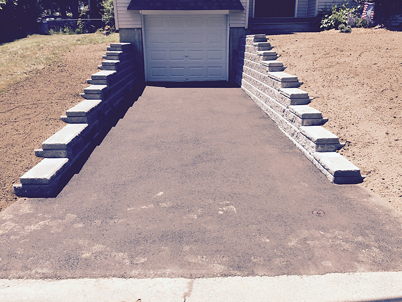 Retaining wall and new asphalt driveway